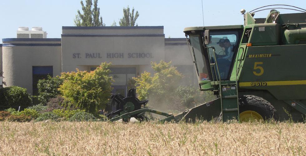 combine in wheat field outside of high school